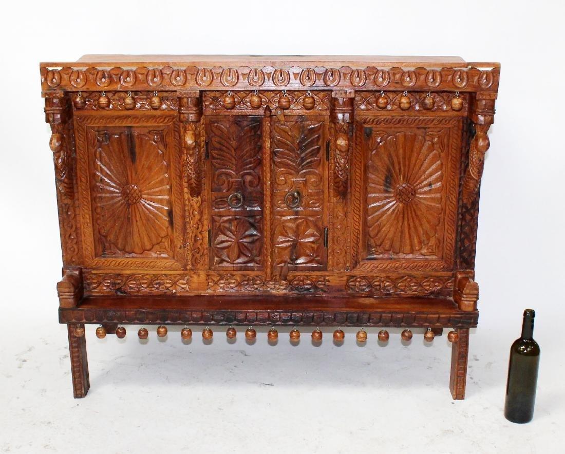 Tibetan carved wooden altar cabinet on legs
