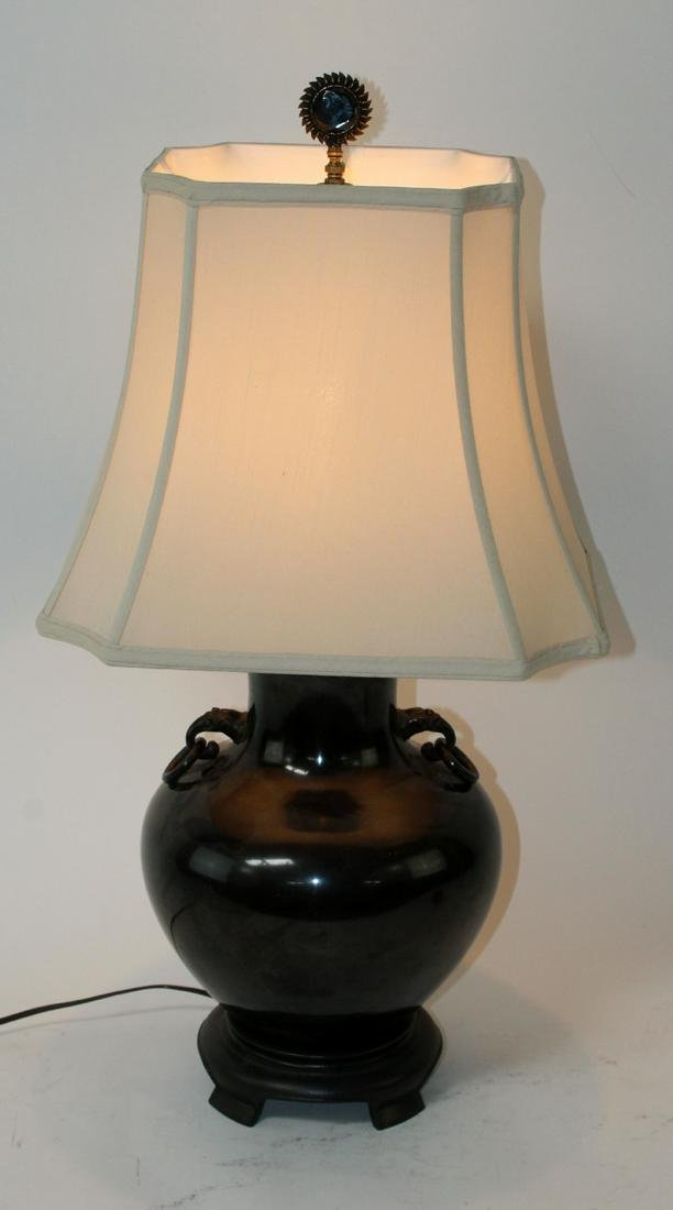 Ceramic table lamp with ring handle