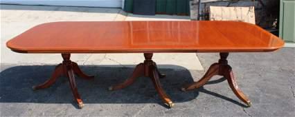 Hepplewhite triple pedestal mahogany dining table