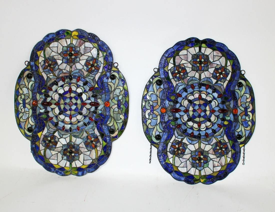 Pair of stained and jeweled glass panels