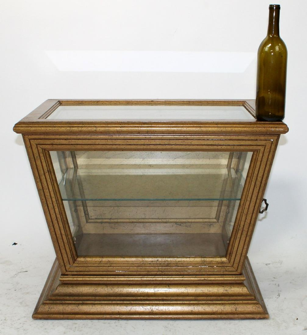 Gilt painted trapezoid display vitrine