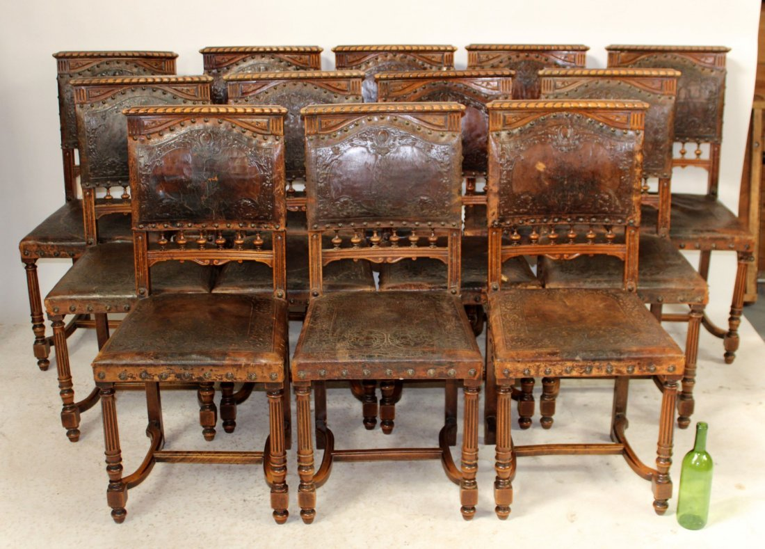 Set of 12 French walnut chairs with tooled leather