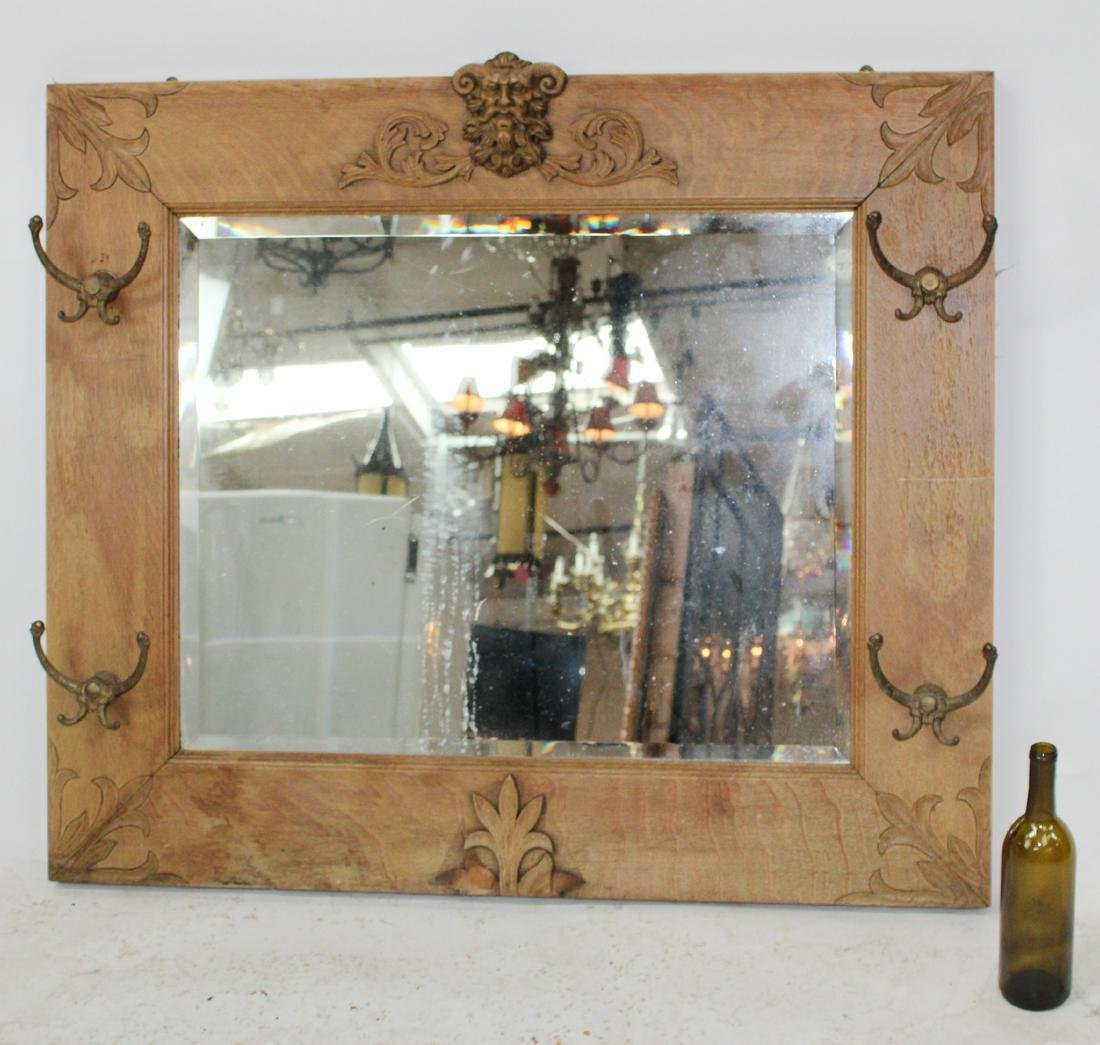 American oak mirror with carved Bacchus