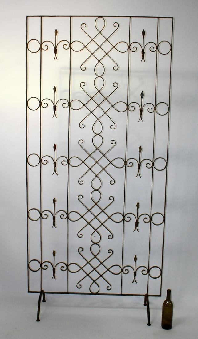 Scrolled iron floor screen
