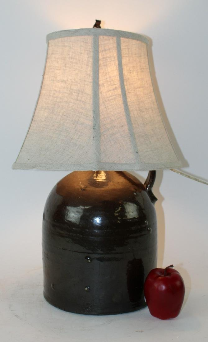 American glazed pottery jug lamp