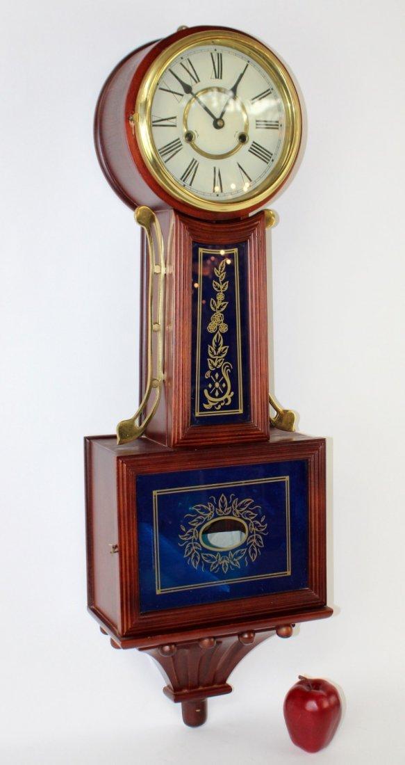 Banjo clock in mahogany case