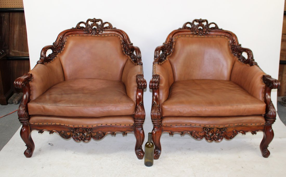Pair of Rococo style carved mahogany & leather chairs