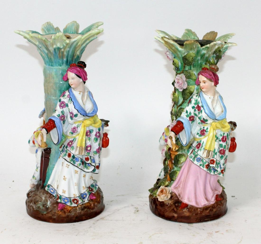 Pair of Chinese figural porcelain candle stands