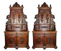 Pair of French carved oak hunt motif buffets