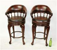 Pair of leather and mahogany barstools