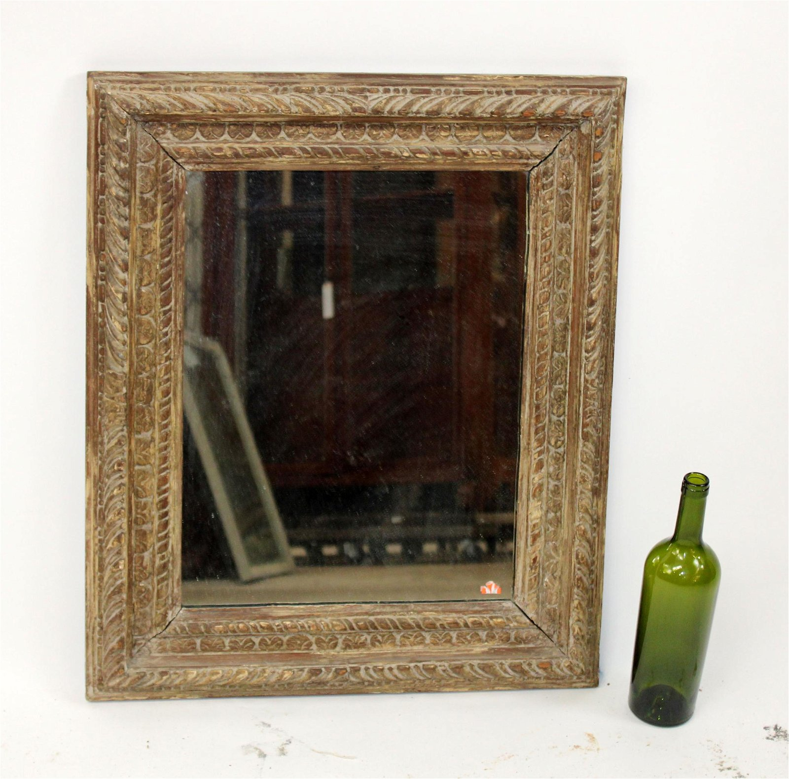 Carved and painted wood mirror