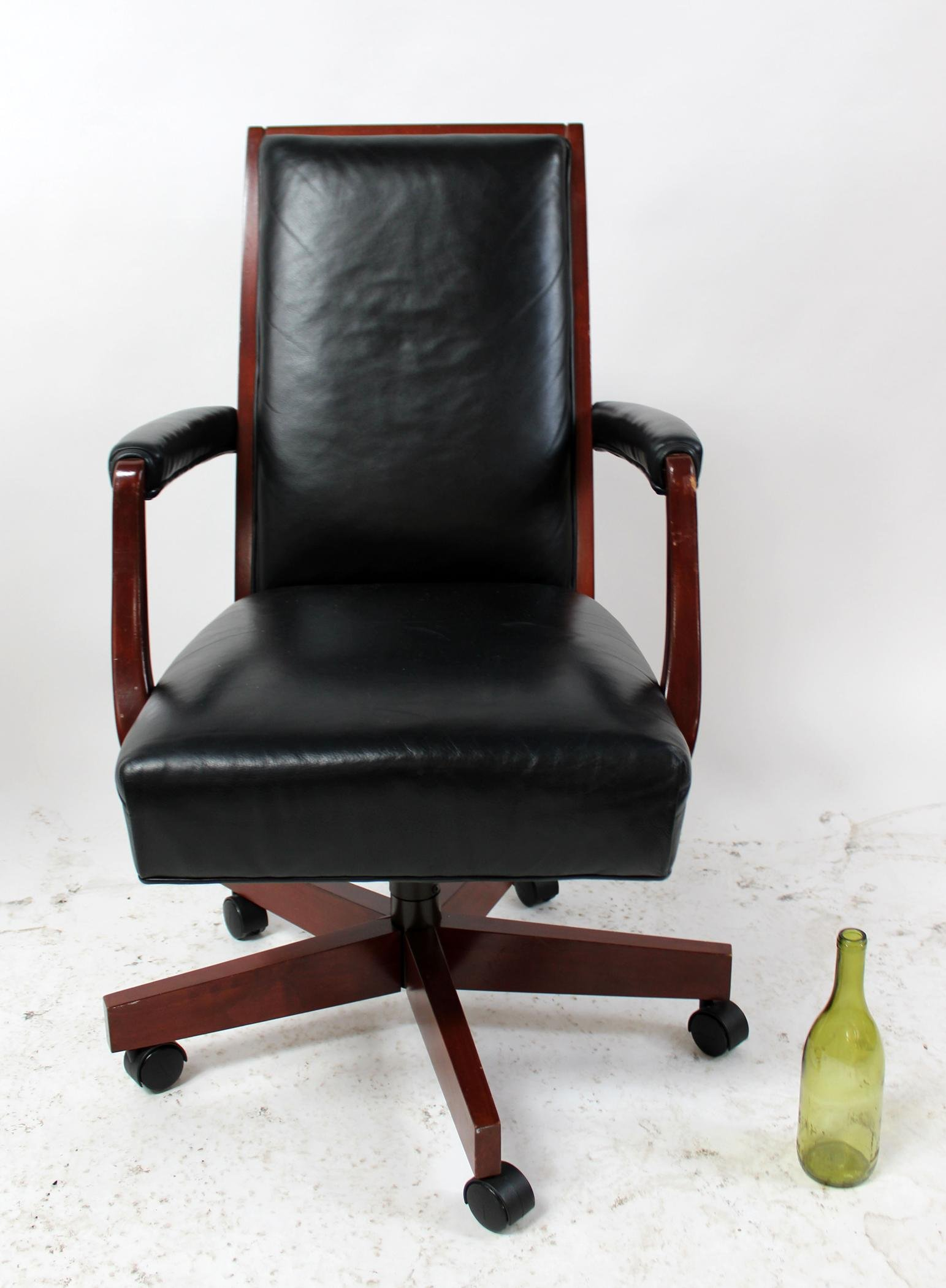 Black leather and mahogany swivel desk chair