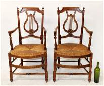 Pair of French walnut harp back armchairs