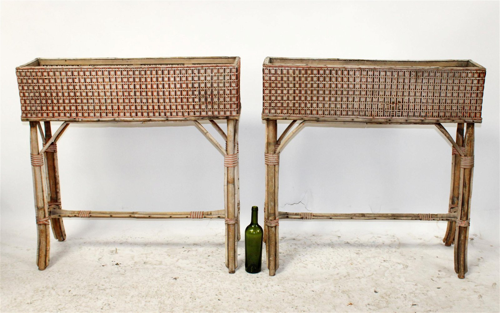 Lot of 2 French wicker planters on bamboo legs
