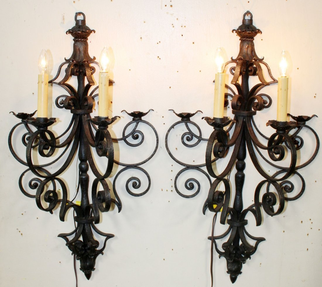 Pair of black wrought iron wall sconces
