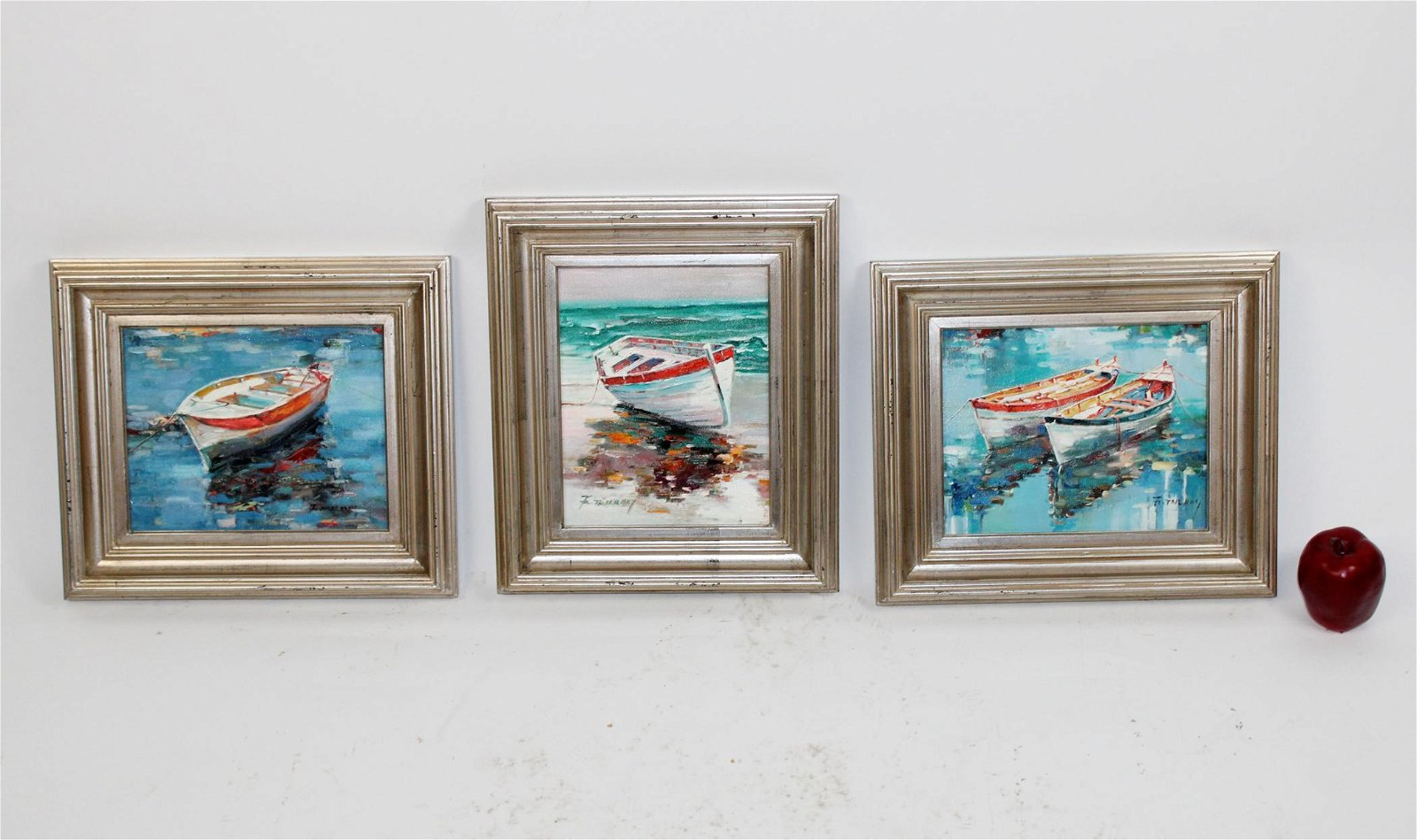 3 oil paintings depicting boats