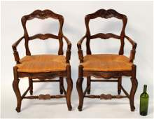 Pair of French Provincial rush seat armchairs