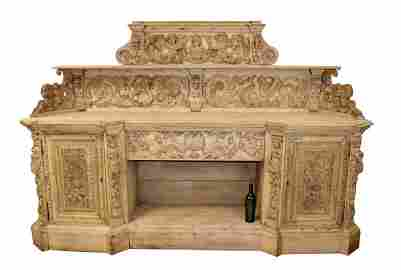 French heavily carved oak sideboard with cherubs