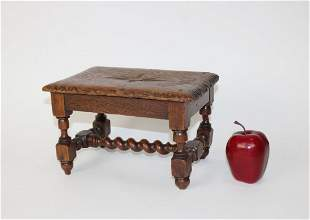 French foot stool in oak with barley twist