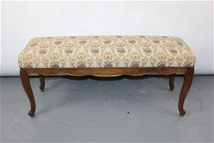French Louis XV style backless bench in carved walnut