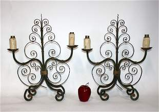 Pair of French scrolled iron candelabra
