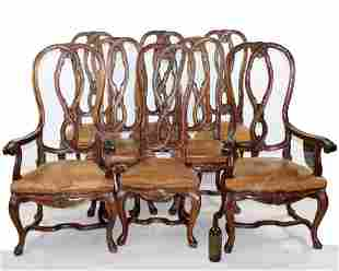 Set of 8 Spanish carved walnut & leather chairs
