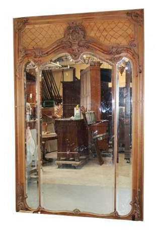 French Regency carved walnut trumeau mirror