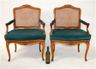 Pair of Louis XV style caned armchairs