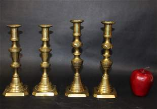 Set of 4 Antique brass candlesticks
