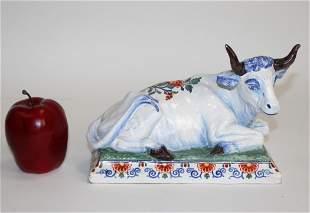 Antique Delft ceramic cow statue