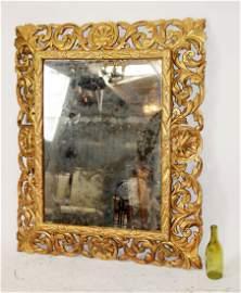 French Baroque pierce carved gold leaf mirror