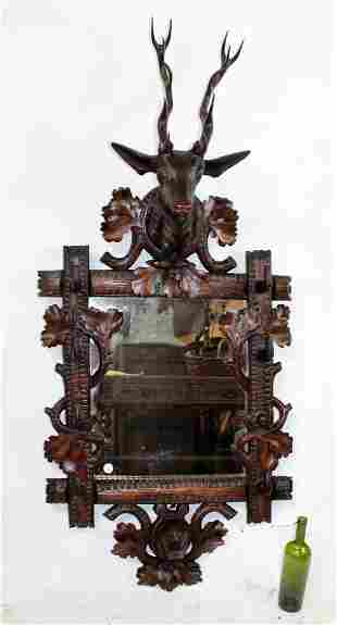 French Black Forest carved gun rack with deer head