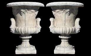Pair of Belgian cast stone urns with Bacchus mask