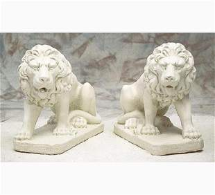 Pair of cast stone crouching entry lions