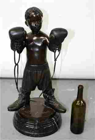 Bronze statue of young boy with boxing attire