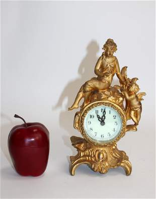 American New Haven figural bronze mantel clock