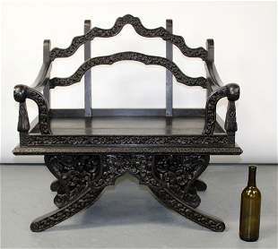 Chinese carved ebonized throne chair