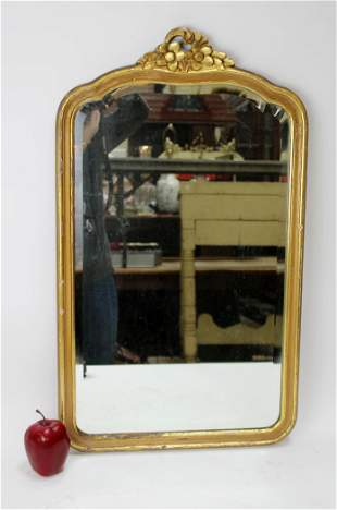 Vintage floral carved and gilt mirror