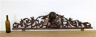 French carved oak crest with globe