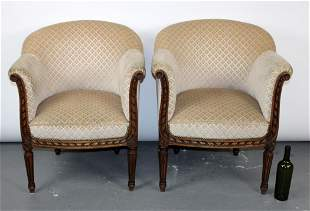 Pair of French Louis XVI curved back club chairs
