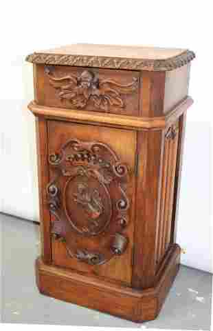 French carved walnut chevet with lion