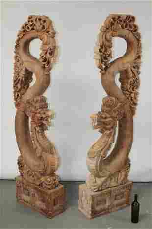 Pair of Chinese heavily carved teak temple dragons