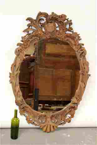 French Louis XV style carved walnut oval mirror