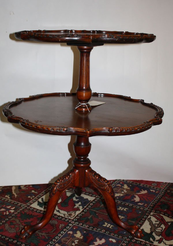 8: Nice carved mahogany 2-tier table with tri-ped base