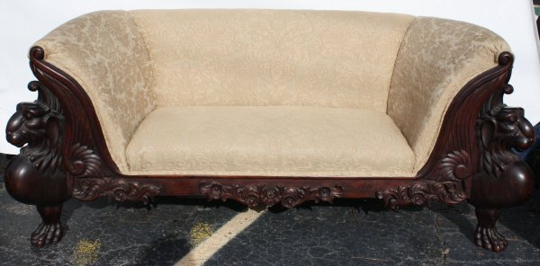 148: Winged Griffin carved mahogany loveseat
