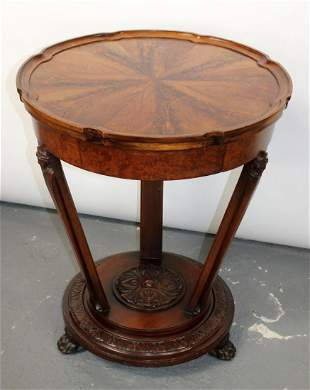 Gueridon table in flame mahogany with paw feet
