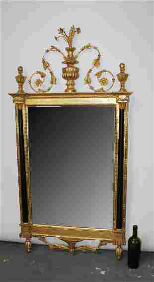 Empire style gilt mirror with focal urn