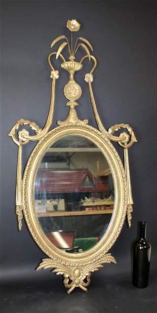 Italian Empire style oval gilt wood mirror