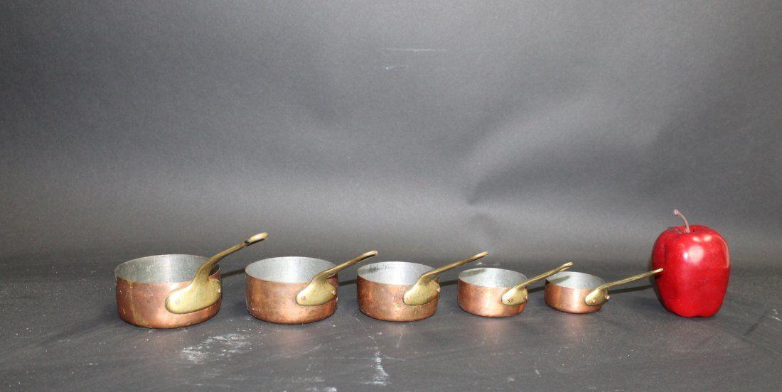Nest of 5 French mini copper pots