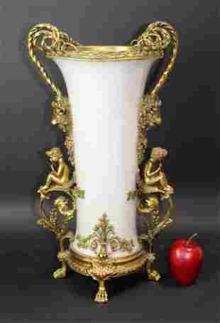 Bronze figural vase with ram heads
